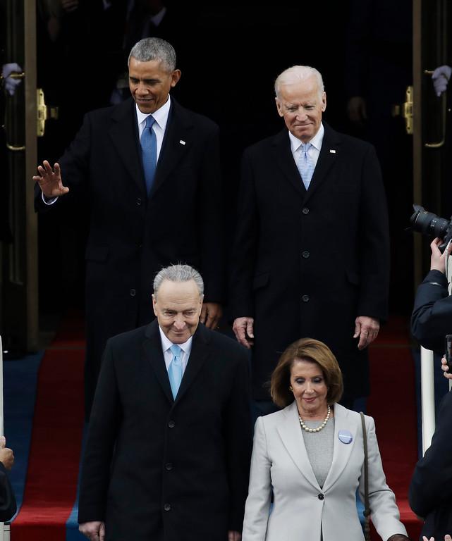 . President Barack Obama, left, arrives with Vice President Joe Biden before the 58th Presidential Inauguration for President-elect Donald Trump at the U.S. Capitol in Washington, Friday, Jan. 20, 2017. (AP Photo/Patrick Semansky)
