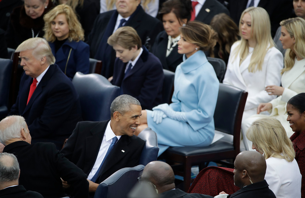 . President Barack Obama looks back at his wife Michelle during the 58th Presidential Inauguration at the U.S. Capitol for President-elect Donald Trump in Washington, Friday, Jan. 20, 2017. (AP Photo/Matt Rourke)