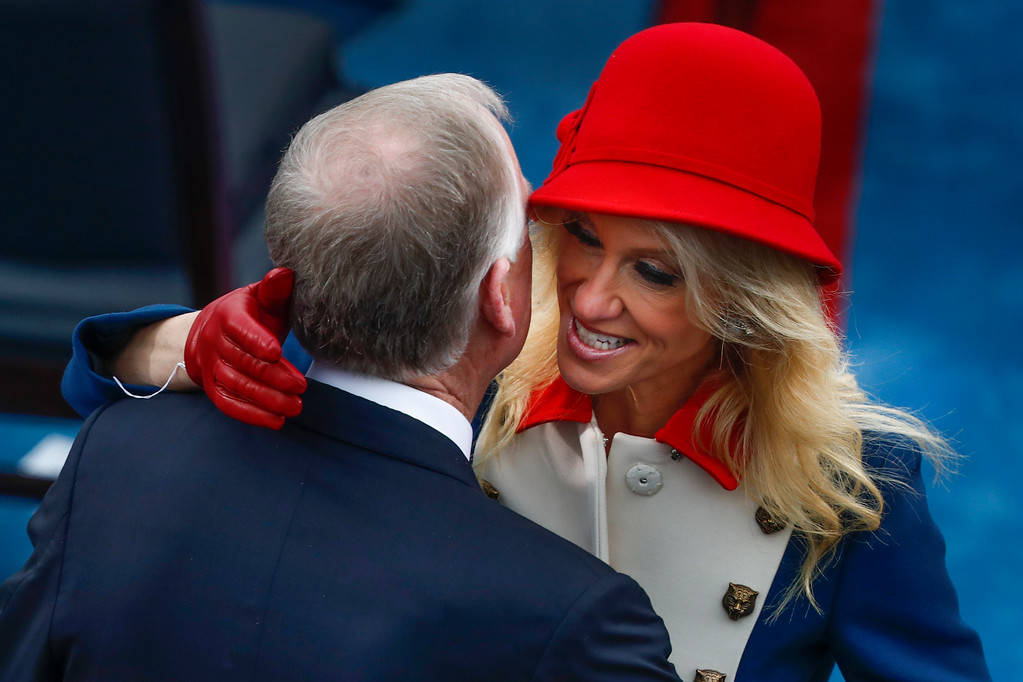 . Former Vice President Dan Quayle greets Kellyanne Conway during the 58th Presidential Inauguration at the U.S. Capitol in Washington, Friday, Jan. 20, 2017. (AP Photo/Carolyn Kaster)
