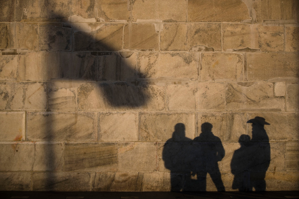 . Shadows are cast on the Washington Monument as preparations continue for Friday\'s inauguration of Donald Trump in Washington, Wednesday, Jan. 18, 2017. (AP Photo/Matt Rourke)
