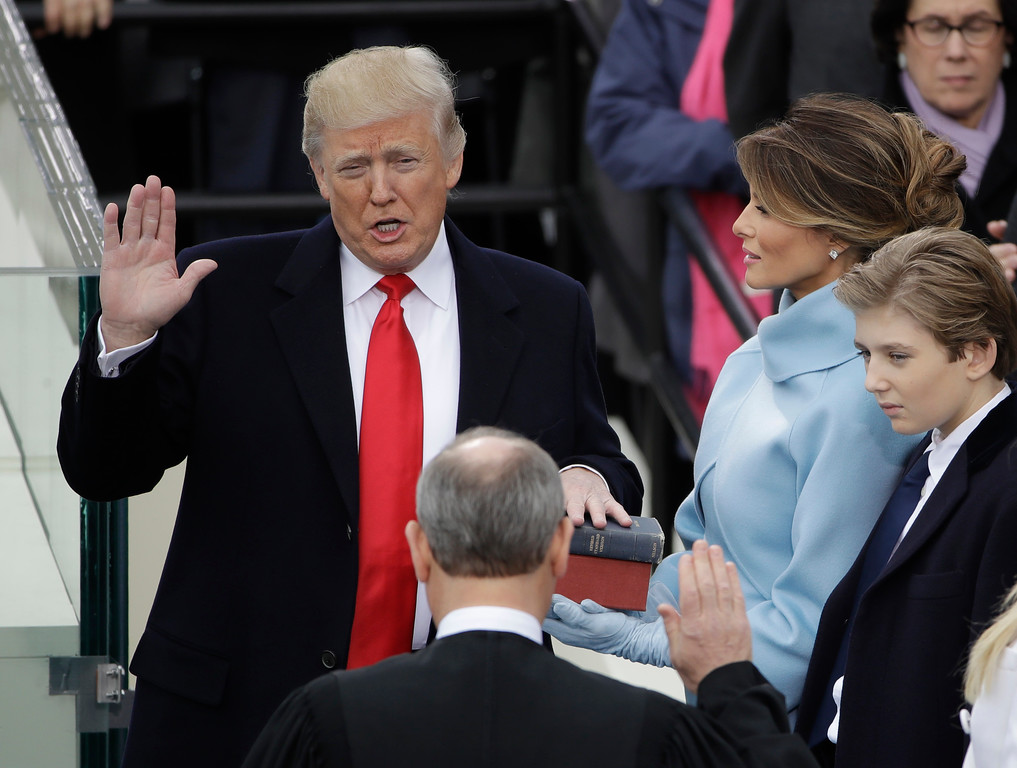 . Donald Trump is sworn in as the 45th president of the United States by Chief Justice John Roberts as Melania Trump looks on during the 58th Presidential Inauguration at the U.S. Capitol in Washington, Friday, Jan. 20, 2017. (AP Photo/Matt Rourke) \'