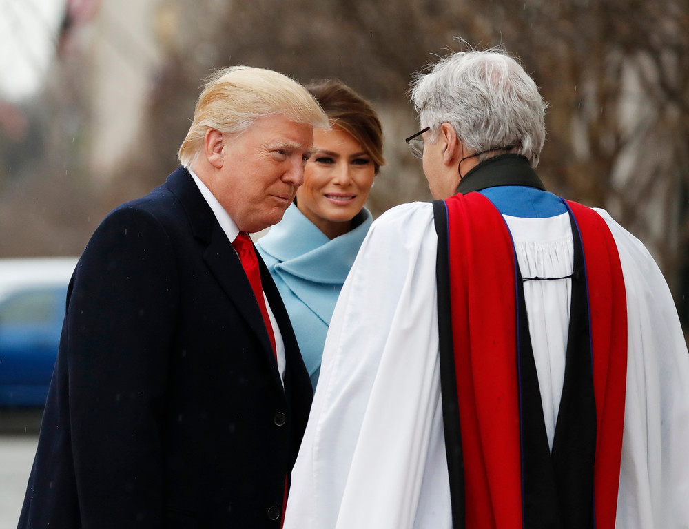 . Rev Luis Leon greets President-elect Donald Trump and his wife Melania as they arrive for a church service at St. John�s Episcopal Church across from the White House in Washington, Friday, Jan. 20, 2017, on Donald Trump\'s inauguration day. (AP Photo/Alex Brandon)