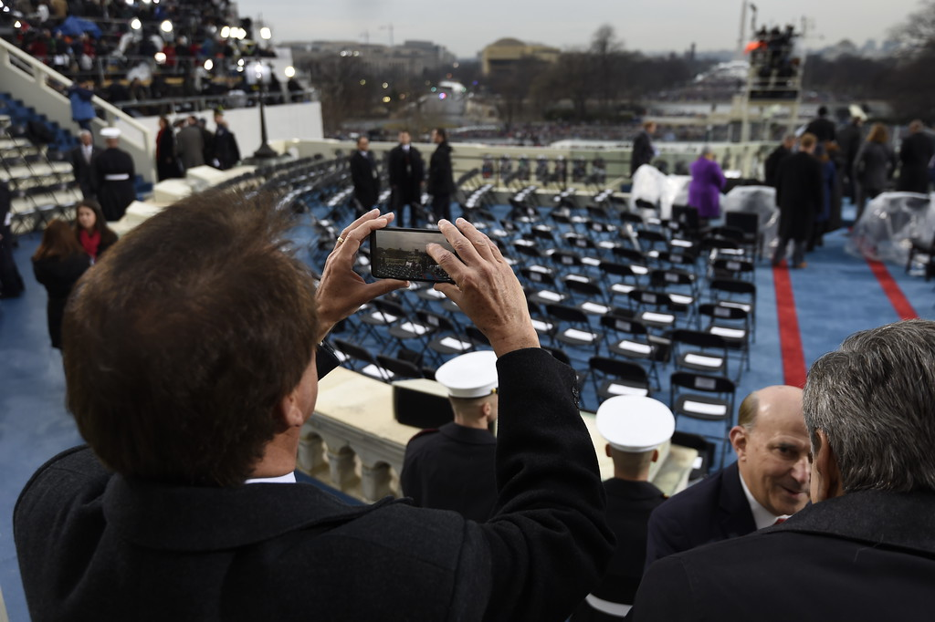 . People gather on the inaugural stage, on Capitol Hill in Washington, Friday, Jan. 20, 2017, before the presidential inauguration Donald Trump. (Saul  Loeb via AP, Pool)