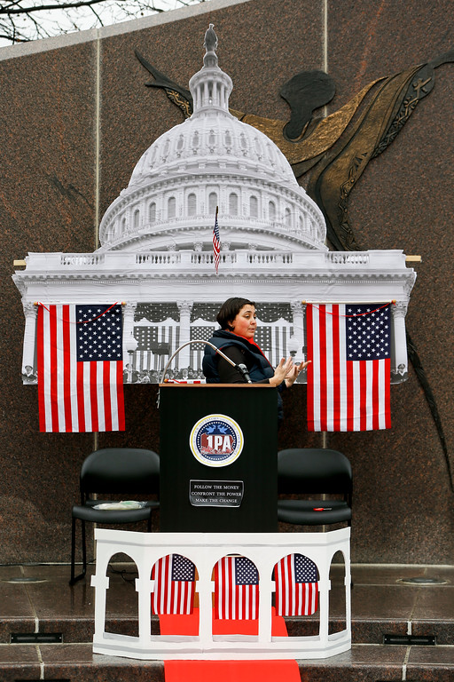 """. Suzy South prepares the area at Freedom Corner where local people are planning to hold a \""""Peoples Inauguration\"""" on Friday, Jan. 20, 2017, in Pittsburgh. (AP Photo/Keith Srakocic)"""