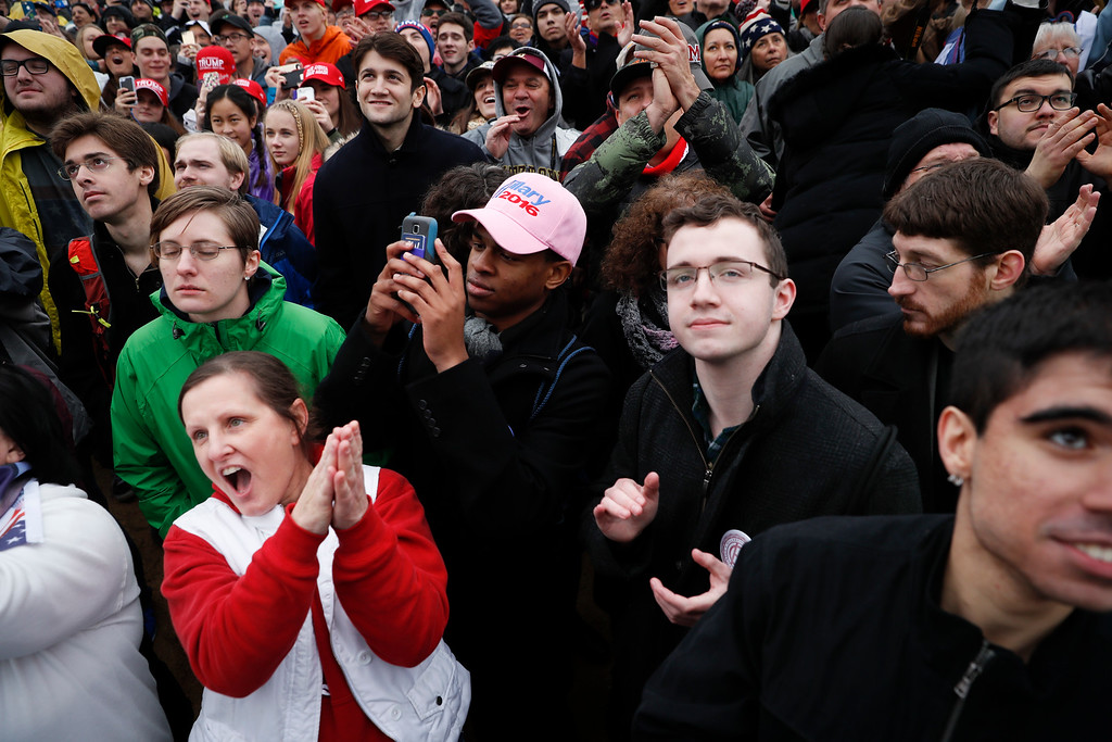 . Spectators react to the arrival of President-elect Donald Trump during the inauguration of President-elect Donald Trump, Friday, Jan. 20, 2017, in Washington. (AP Photo/John Minchillo)