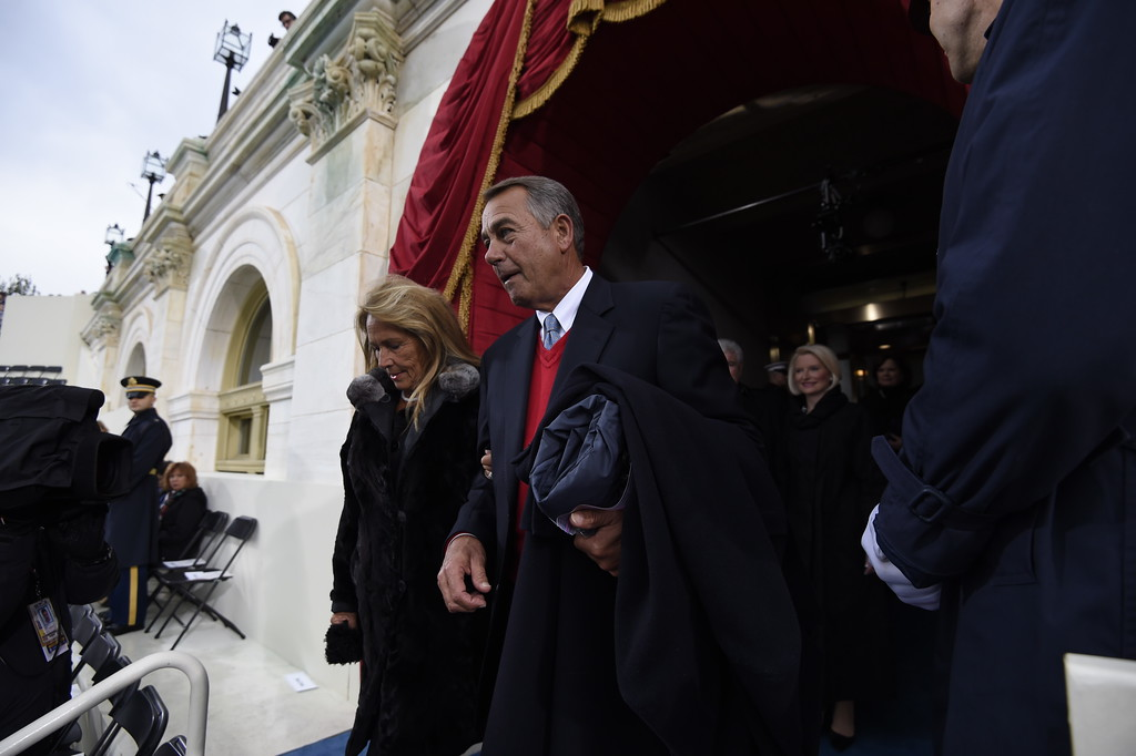 . Former Speaker of the House John Boehner and his wife Debbie arrive for the Presidential Inauguration of Donald Trump at the US Capitol in Washington, DC, January 20, 2017. / AFP PHOTO / POOL / SAUL LOEB