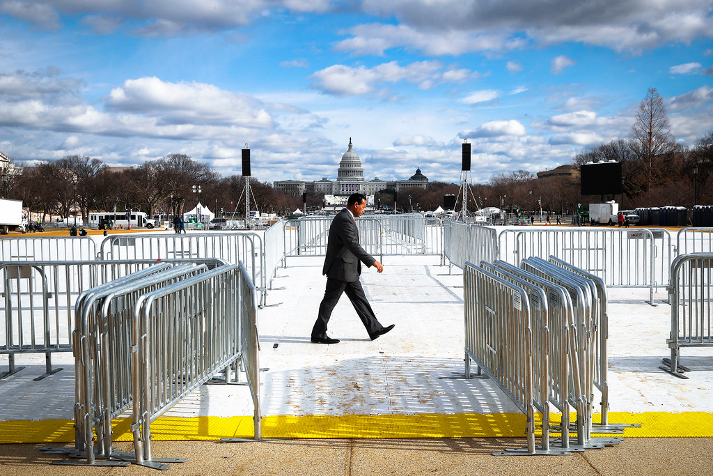 . A pedestrian walks through the National Mall in Washington, Wednesday, Jan. 18, 2017, with the Capitol in the background, as work continues in preparation for Friday\'s presidential inauguration. (AP Photo/John Minchillo)