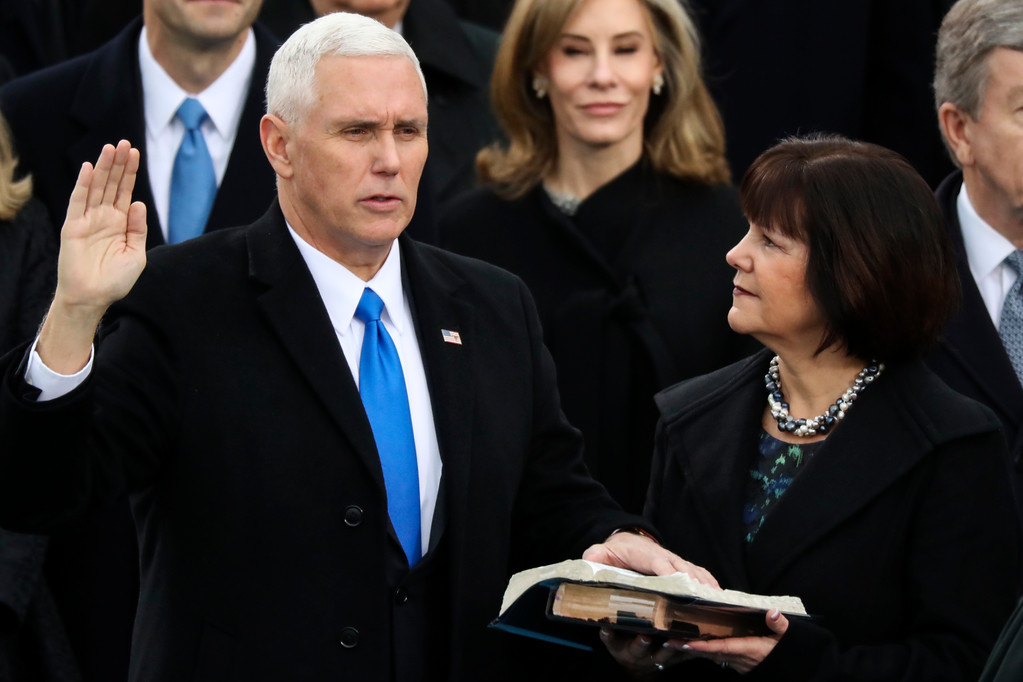 . Vice President Mike Pence is sworn in as this wife Karen holds the bible during the 58th Presidential Inauguration at the U.S. Capitol in Washington, Friday, Jan. 20, 2017. (AP Photo/Andrew Harnik)