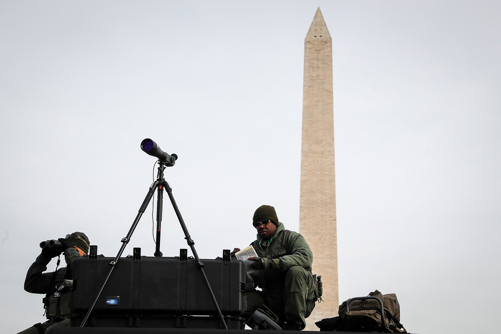 . With the Washington Monument looming, SWAT personnel keep watch, Thursday, Jan. 19, 2017, as preparations continue for Friday\'s presidential inauguration. (AP Photo/John Minchillo)