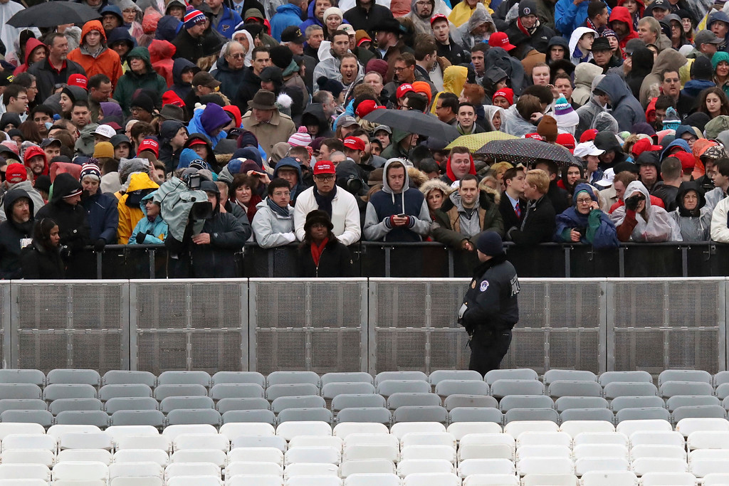 . A Capitol Hill police officer watches the crowd before the swearing in of Donald Trump as the 45th president of the United States during the 58th Presidential Inauguration at the U.S. Capitol in Washington. Friday, Jan. 20, 2017 (AP Photo/Andrew Harnik)