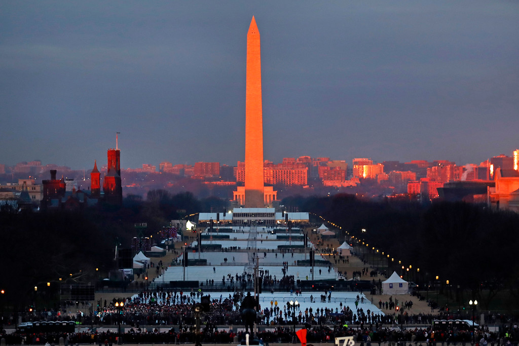 . The crowd starts to fill the National Mall as the sun rises before the swearing in of Donald Trump as the 45th President of the Untied State during the 58th Presidential Inauguration at the U.S. Capitol in Washington. Friday, Jan. 20, 2017 (AP Photo/Carolyn Kaster)
