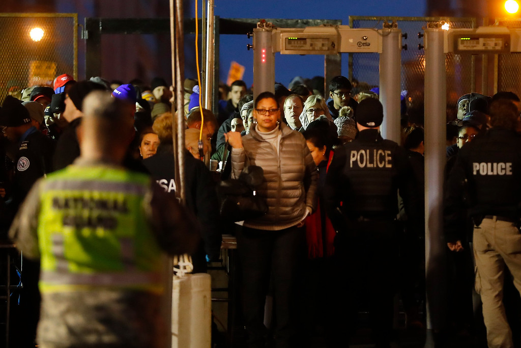 . Spectators pass through a security checkpoint to gain access to Pennsylvania Avenue before the presidential inauguration of President-elect Donald Trump, Friday, Jan. 20, 2017, in Washington. (AP Photo/John Minchillo)