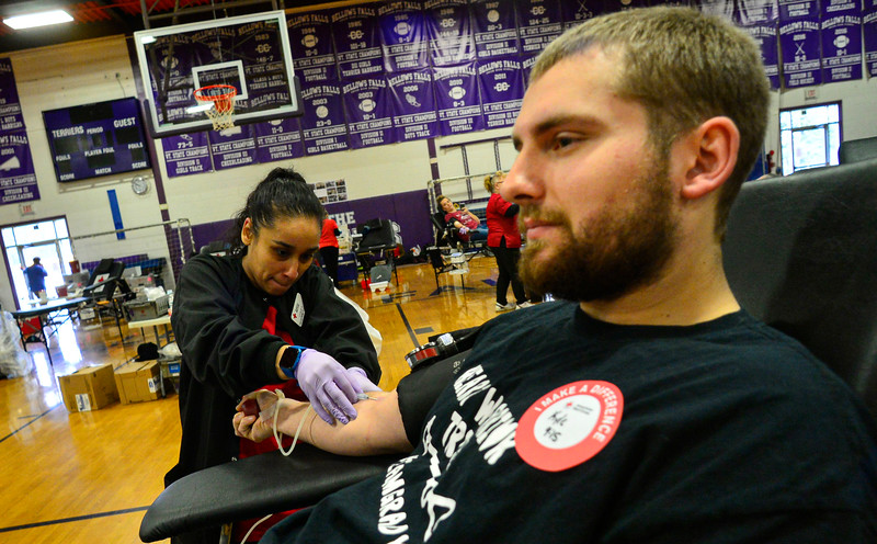 KRISTOPHER RADDER — BRATTLEBORO REFORMER<br /> Leslie Santiago, a phlebotomist for American Red Cross, draws the blood from Kyle O'Rourke during a blood drive in honor of Grady Oliver Evans at Bellows Falls Union High School, in Westminster, Vt., on Saturday, Feb. 29, 2020.