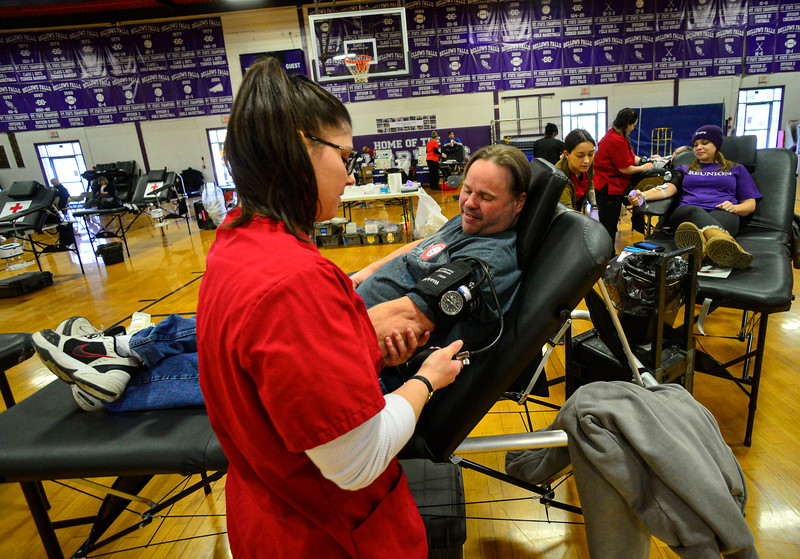 KRISTOPHER RADDER — BRATTLEBORO REFORMER<br /> Casey Lauter, a phlebotomist for American Red Cross, checks the blood pressure of James Tallent, of Bellows Falls, during a blood drive in honor of Grady Oliver Evans at Bellows Falls Union High School, in Westminster, Vt., on Saturday, Feb. 29, 2020.