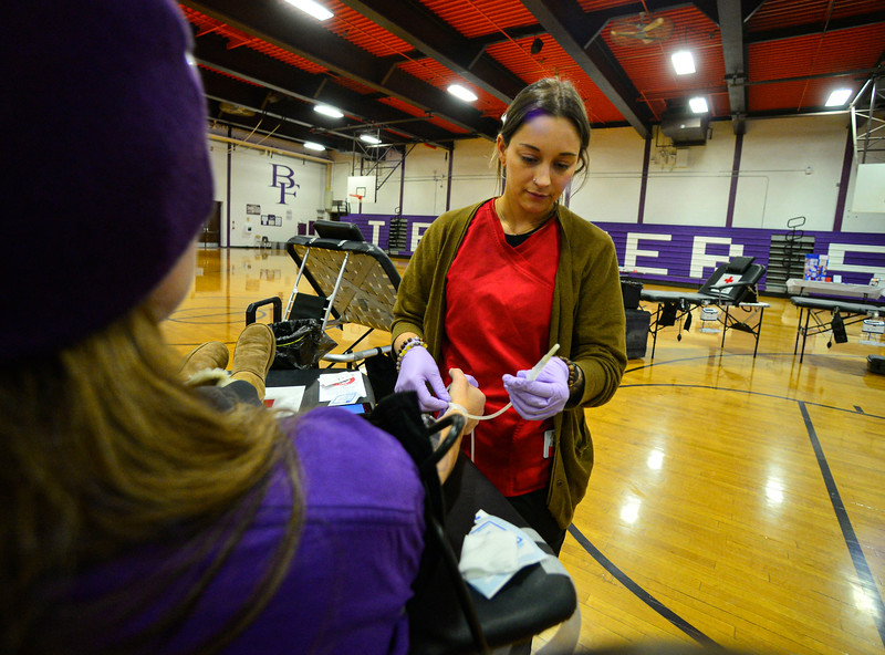 KRISTOPHER RADDER — BRATTLEBORO REFORMER<br /> Laura Fiandaca, a phlebotomist for American Red Cross, takes blood from Whitney Patterson during a blood drive in honor of Grady Oliver Evans at Bellows Falls Union High School, in Westminster, Vt., on Saturday, Feb. 29, 2020.