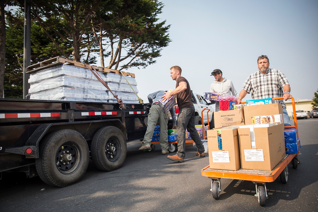 . Supervisor Rex Bohn takes supplies funded by donations that are headed down to Santa Roas early Wednesday morning. (Sam Armanino - The Times-Standard)