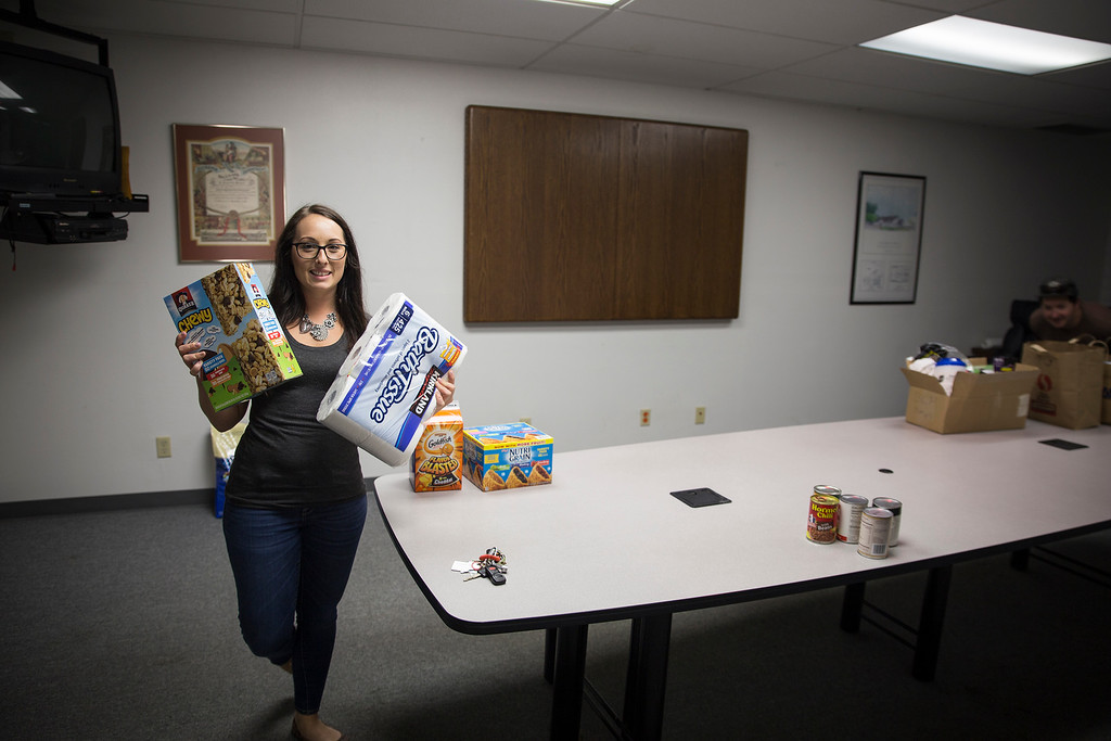 . Ashleigh Jordan, Humboldt Bay Fire employee, holds some of the first donations of the day.  (Sam Armanino - The Times-Standard)