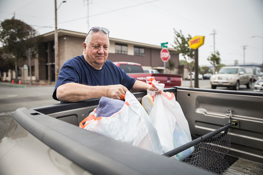 . Mervyn Dody, Eureka resident, pulls bags of donated clothes and towels for people devestated by the fires to the south.  (Sam Armanino - The Times-Standard)