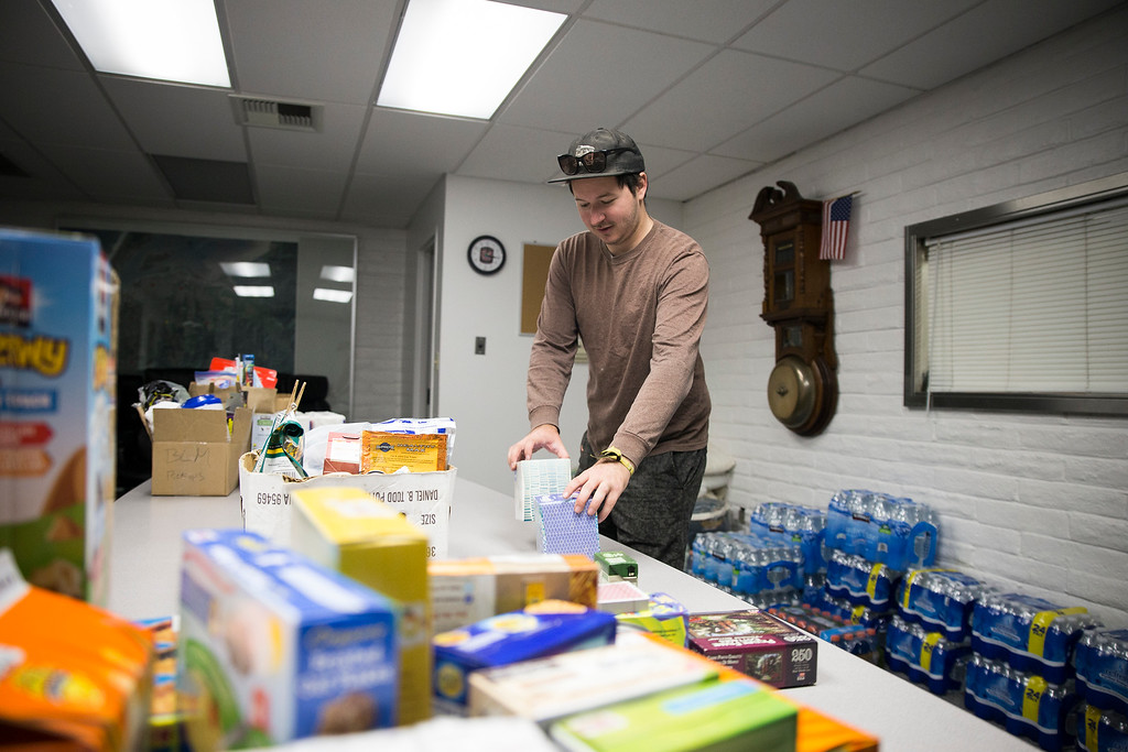 . Eureka City Councilmember Austin Allison gathers supplies in the Humboldt Bay Fire station on Tuesday.  (Sam Armanino - The Times-Standard)