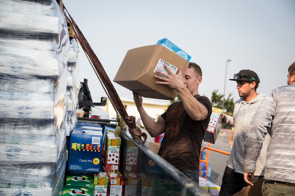 . Cody King, Fortuna resident,  loads a box of supplies to drive down to Santa Rosa to help the evacuees from the fires on Tuesday. (Sam Armanino - The Times-Standard)