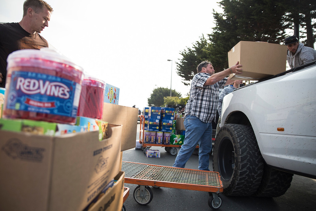 . Supervisor Rex Bohn loads of box of food to be taken to Santa Rosa early Wednesday morning at 4 a.m. (Sam Armanino - The Times-Standard)
