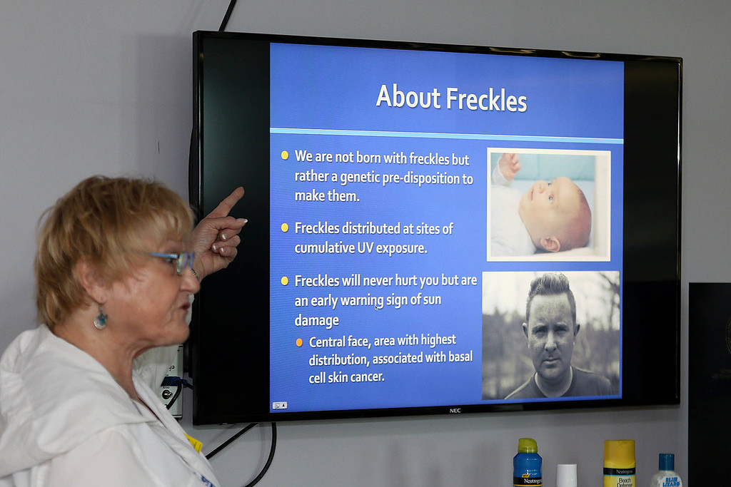 ". Sixth graders at Stony Brook School listened to Maura Flynn from the Children\'s Melanoma Prevention Foundation for ""Don\'t Fry Day,\"" an educational event aimed at preventing skin cancer with young students. She explain to them what freckles are. SUN/JOHN LOVE"