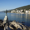 A view of the coastline of Opatija, with the statue of the Girl with a Seagull.