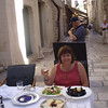 Lunch inside the city walls of Dubrovnik - grilled mussels, greek salad, and beer