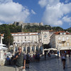 The main square of Hvar town, with the castle in the background.