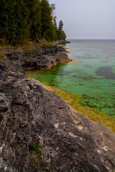 """The rugged shoneline at Whitefish Dunes State Park in Door County, WI.  <br><br><i><a href=""""http://chuck-de-la-rosa.artistwebsites.com/featured/clear-water-at-whitefish-dunes-chuck-de-la-rosa.html"""" target=""""_blank"""">Click here to order prints of this photo!</a></i><br>"""