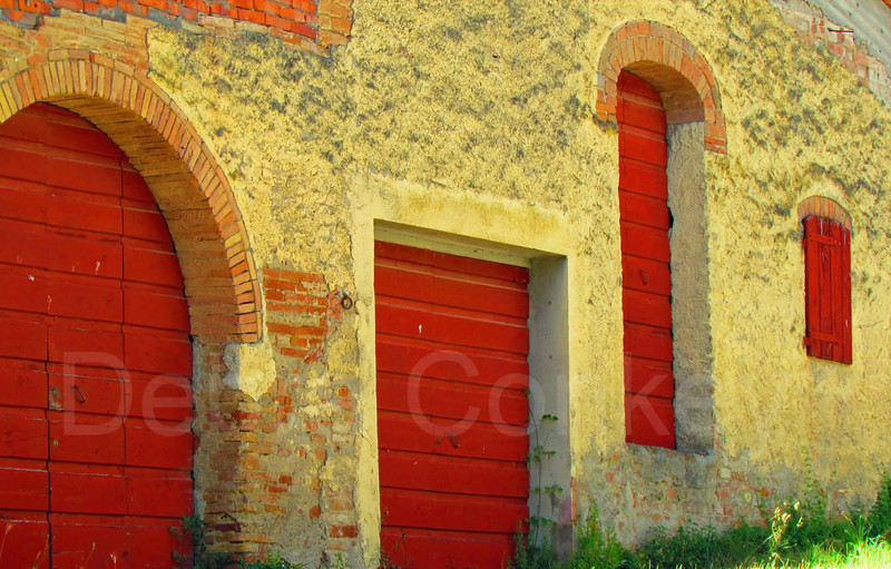 Four red doors, Tuscany, Italy