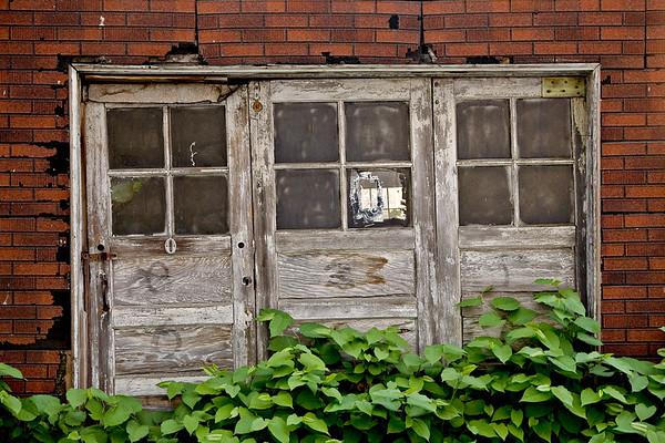 Doors on Old House, Seattle, Washington