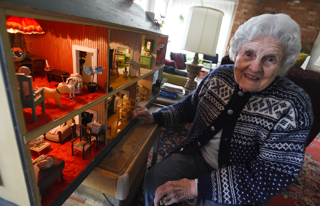 . Doris Hass, 97, of Boulder, is with the dollhouse her father and paternal grandfather built for her around 1925 when the family lived on Long Island in New York.  Cliff Grassmick  Photographer January 12, 2018