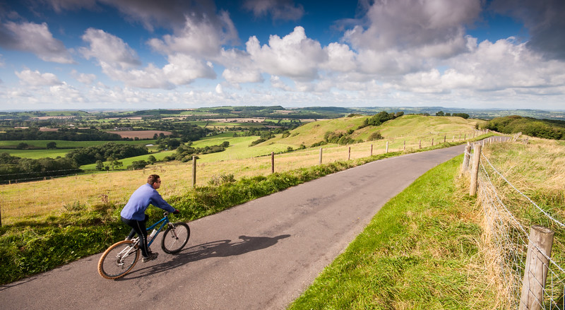 Cyclist on hill in Dorset, England