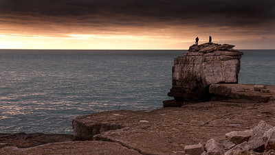 Climbers on Pulpit Rock at sunset