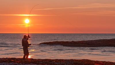 Pêcheur au coucher de soleil, embouchure de la rivière Jupiter