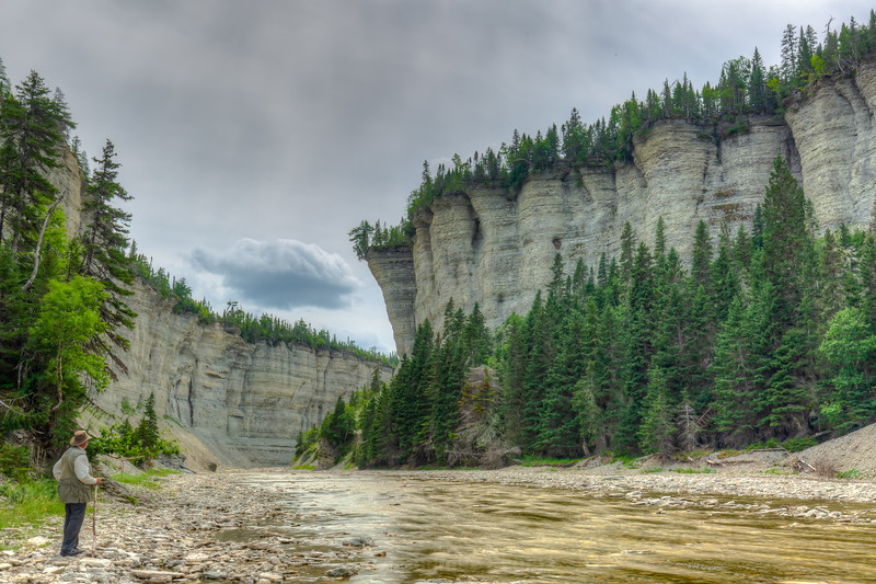 A man, a breathaking scenery, Vaureal canyon, Anticosti
