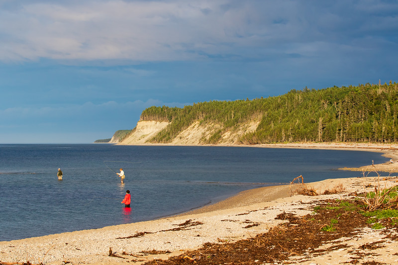 Fly fishing for sea trout at the mouth of the Patate River, Anticosti Island