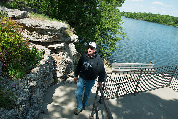 Globe/Roger Nomer<br /> Bob Forrest walks along his lake-front property at Crawford State Park on Thursday.