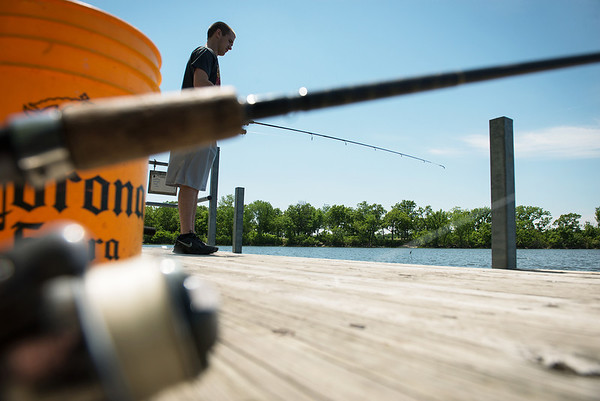Globe/Roger Nomer<br /> Garret Sturgis, Galena, fishes for catfish at Crawford State Park on Thursday afternoon.
