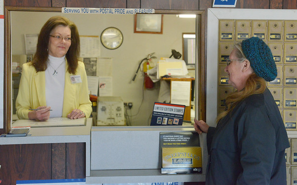 Globe/Roger Nomer<br /> Postmaster Rhonda Snyder talks with customer Leta Wilson on Wednesday afternoon at the Neck City Post Office.