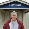 Globe/Roger Nomer<br /> Mayor Don Hole talks about his history with Neck City in front of city hall on Wednesday.