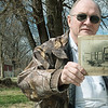 Globe/Roger Nomer<br /> Local Neck City historian Gary Miller holds a photo of Dr. W.G. Hogan's office and drug store, a main fixture of downtown Neck City in 1912.