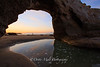 Sunrise Light reflecting under an Arch, Santa Cruz Beach, California
