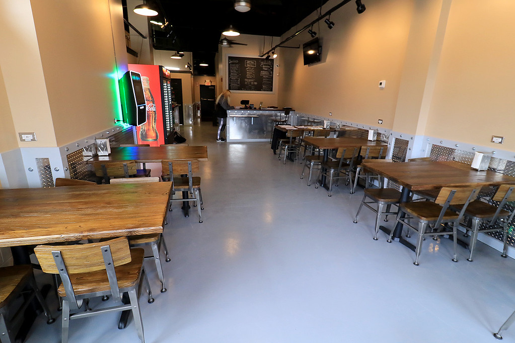 . The new Fitchburg Pizza restaurant DoughBoys on Main will be officially open on Wednesday morning, January 29, 2019. On Tuesday they were making few pizza as tests. Some of their seating. SENTINEL & ENTERPRISE/JOHN LOVE