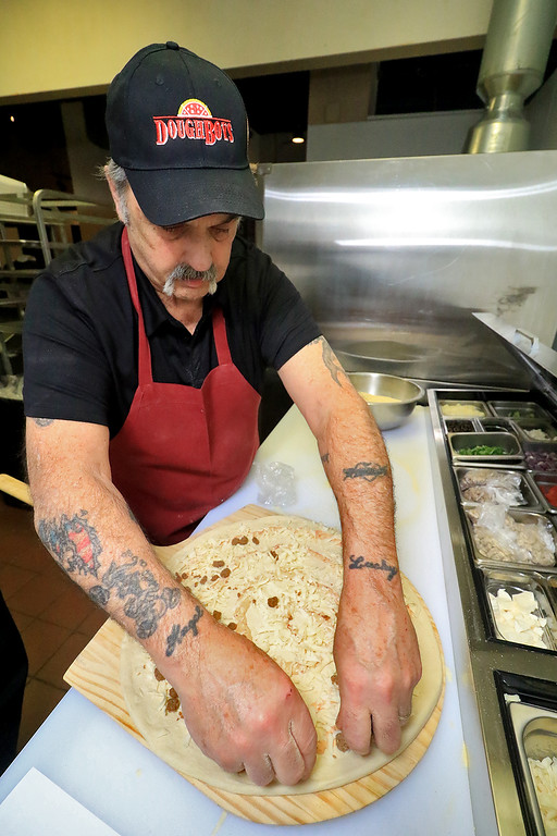 """. The new Fitchburg Pizza restaurant DoughBoys on Main will be officially open on Wednesday morning, January 29, 2019. On Tuesday they were making few pizza as tests. Frank Gordon puts together their \""""Fitchburger\"""" pizza. SENTINEL & ENTERPRISE/JOHN LOVE"""