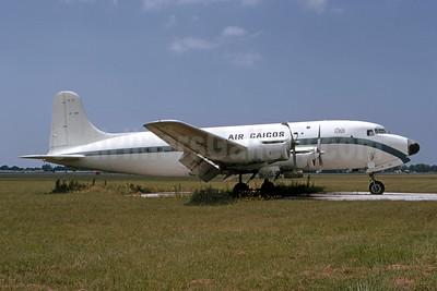 Air Caicos Canadair North Star (Douglas C-54GM) (DC-4M) (Argonaut) CF-UXB (msn 117) SRQ (Bruce Drum). Image: 105502.
