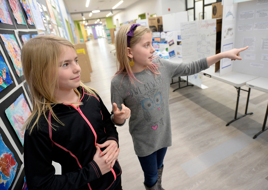 . BOULDER, CO - November 29, 2018: Sara Chreist, left, and Clara Rhey, shared a project that talked about Malala helping girls get an education at the Kids Care Expo at Douglass Elementary in Boulder.  (Photo by Cliff Grassmick/Staff Photographer)