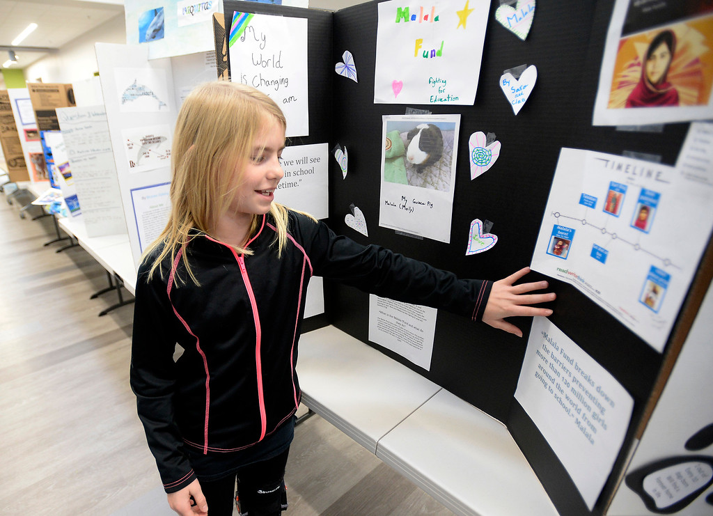 . BOULDER, CO - November 29, 2018:  Sara Chreist, left, (pictured) and Clara Rhey, shared a project that talked about Malala helping girls get an education  at the Kids Care Expo at Douglass Elementary in Boulder.  (Photo by Cliff Grassmick/Staff Photographer)