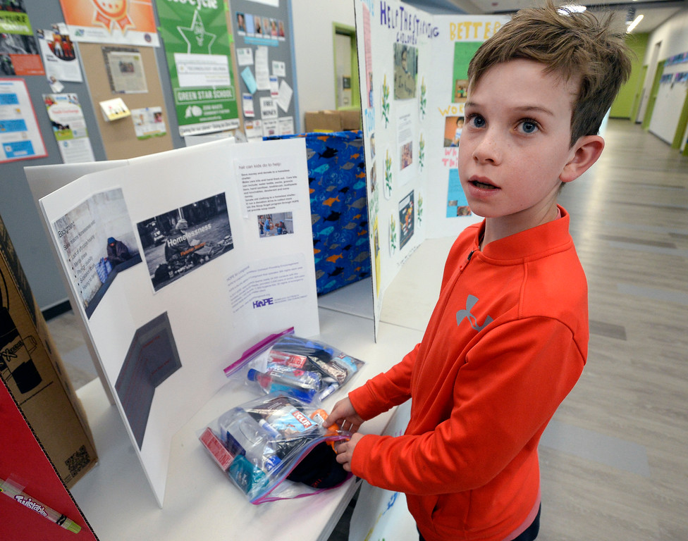 . BOULDER, CO - November 29, 2018:  Fletcher Morton, a fifth-grader, hopes to help the homeless with his project at the Kids Care Expo at Douglass Elementary in Boulder.  (Photo by Cliff Grassmick/Staff Photographer)